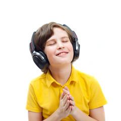 Smiling boy in headphones listening to music, eyes closed