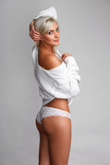 portrait of sexy woman in sweater and panties