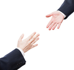 Businessman giving helping hand to business team partner