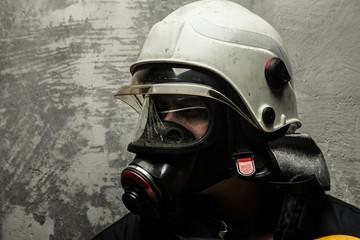 Firefighter in helmet and oxygen mask