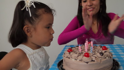 Five Year Old Girl Blowing Candles