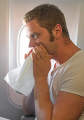 Airsickness. Man feels very bad on the plane.