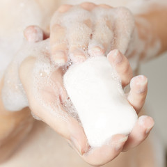 Female hand with soap