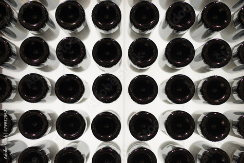 Many wine bottles. Bottom view. плакат