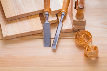 composition of woodworking tools carpentry chisels and plane on