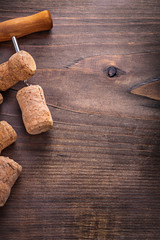 corks of champagne on corkscrew wooden board with copyspace
