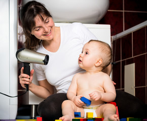Mother and baby - drying hairs