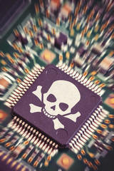 Macro shot of a motherboard with microchip and pirate symbol