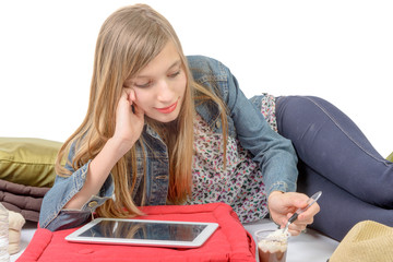 a teenager  eating yogurt