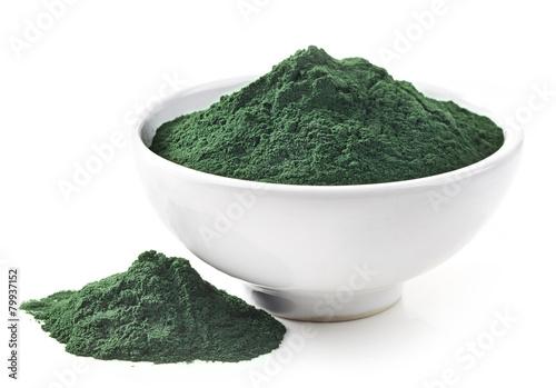 Leinwanddruck Bild bowl of spirulina algae powder