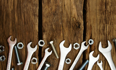 Fixing elements (nuts, washers, screws) and wrenches on wooden