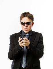 Teenage boy posing like a guardsman with radio transmitter