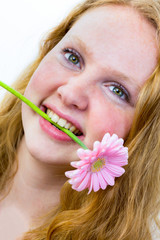 Face of a girl with pink flower