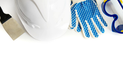 Many working tools - helmet, glove and others on white