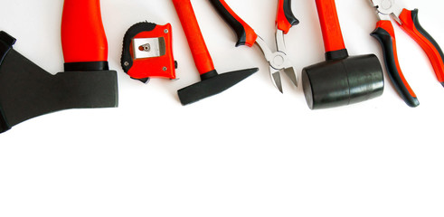 Many working tools - axe, hammer, pliers and others on white