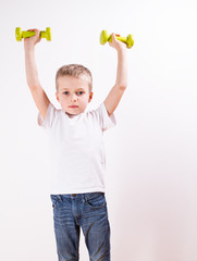 Young boy with weights Fitness
