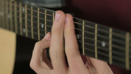 Close-up of strings on a guitar while playing