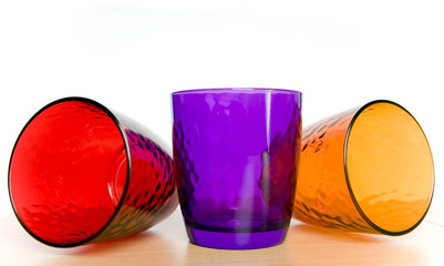 colorful glass cups on a white background
