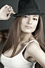 girl wearing a fedora hat