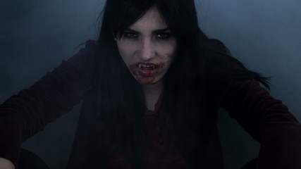 Beautiful female vampire with fog light and blood thinking