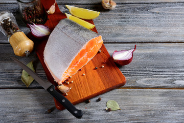 Fresh Salmon steak slices on a cutting board. Cooking concept