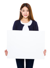 Asian woman showing banner