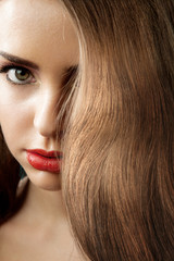Woman with shiny hair and red lips