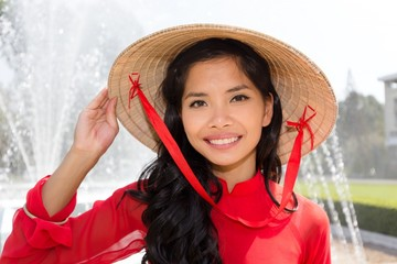 Smiling Vietnamese woman in a red Ao Dai
