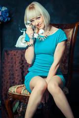 girl talking on retro telephone.