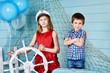 Children with steering wheel on voyage