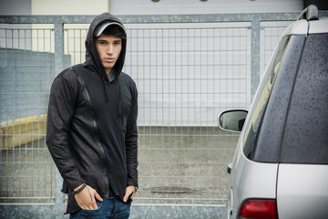 Young man in a winter anorak with hood