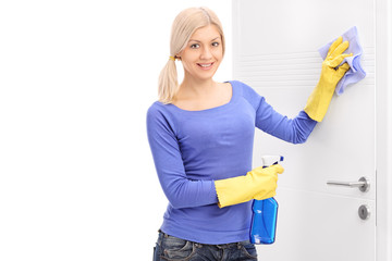 Woman cleaning a door with rag