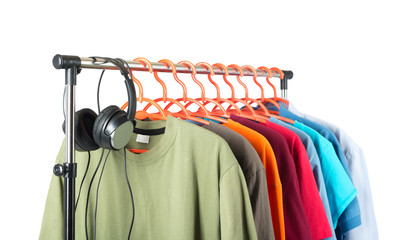 Clothing and headphones on the hanger, white background.