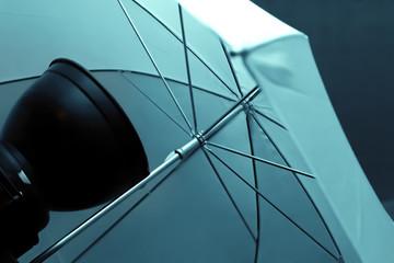 White umbrella in photo studio equipment