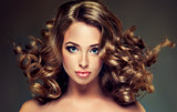 Fototapety Beautiful model brunette with long curled hair