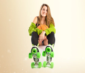 Pretty young girl wearing urban style with roller-skates