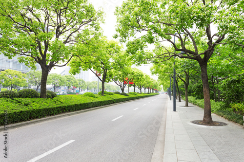 Deurstickers China Trees decorated road in modern city