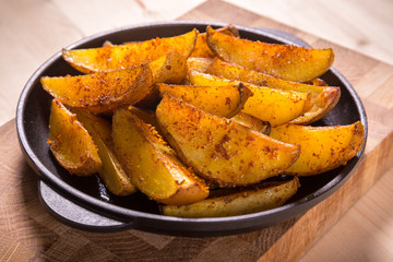 baked sliced potatoes on pan