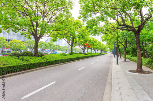 Fotobehang China Trees decorated road in modern city