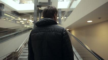 A man in a mall escalator