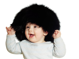 Caucasian baby boy in big black hat isolated