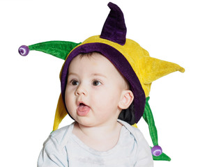 Caucasian baby boy wearing a colored party hat isolated
