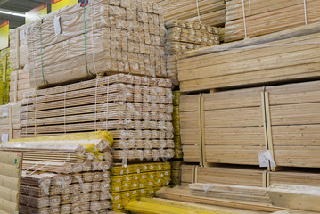 Astack of lumber in the store timber