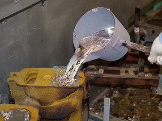 operator pouring aluminum automotive parts
