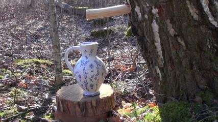birch sap drops in decorative ceramic pitcher jar jug
