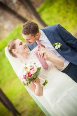Bride pulling tie