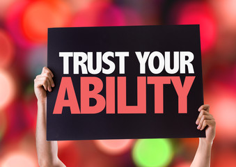 Trust Your Ability card with bokeh background