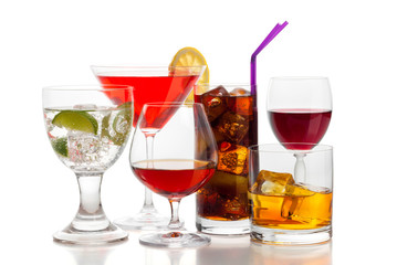 Alcoholic drinks on white background