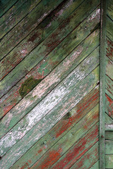 Green Background with grunge old wooden wall with flaking paint