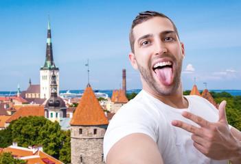 Happy young man taking a selfie photo in Tallinn, Estonia